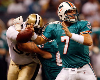 NEW ORLEANS - AUGUST 28:  Miami Dolphins Chad Henne #7 fumbles the ball after being stripped by New Orleans Saints defensive end Sedrick Ellis #98 during the second quarter of their final preseason game at the Louisiana Superdome on August 28, 2008 in New