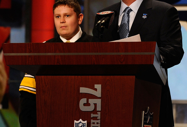 NEW YORK - APRIL 22:  NFL Commissioner Roger Goodell introduces 16-year old Zachary Hatfield (L) from Florence, KY, Hatfield then made the announcement that Maurkice Pouncey from the Florida Gators was selected by the Pittsburgh Steelers number 18 overall