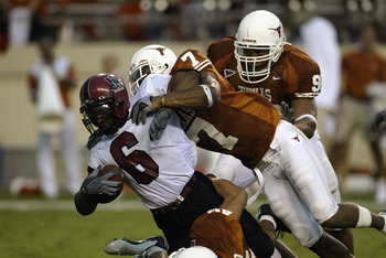 AUSTIN, TX - AUGUST 31:  Safety Michael Huff #7 and defensive tackle Rodrique White #90 of the University of Texas at Austin Longhorns stops Keith Mouton #6 of the New Mexico State University Aggies at Texas Memorial Stadium on August 31, 2003 in Austin,