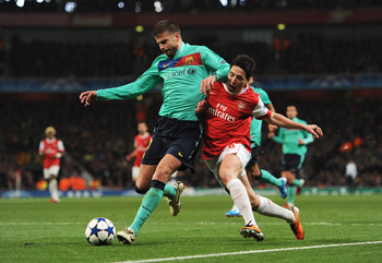 LONDON, ENGLAND - FEBRUARY 16: Samir Nasri of Arsenal challenges Gerard Pique of Barcelona during the UEFA Champions League round of 16 first leg match between Arsenal and Barcelona at the Emirates Stadium on February 16, 2011 in London, England.  (Photo