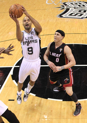 SAN ANTONIO, TX - MARCH 04:  Guard Tony Parker #9 of the San Antonio Spurs takes a shot against Mike Bibby #0 of the Miami Heat at AT&T Center on March 4, 2011 in San Antonio, Texas.   NOTE TO USER: User expressly acknowledges and agrees that, by download