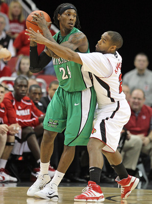 LOUISVILLE, KY - NOVEMBER 27: Preston Knowles #2 of the Louisville Cardinals defends DeAndre Kane #24 of the Marshall Thundering Herd during the game at the KFC Yum! Center on November 27, 2010 in Louisville, Kentucky.  Louisville won 80-66.  (Photo by An