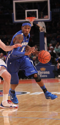 NEW YORK, NY - DECEMBER 07:  Will Barton #5 of the Memphis Tigers drives to the basket against Brady Morningstar #12 of the Kansas Jayhawks during their game at the Jimmy V Classic at Madison Square Garden on December 7, 2010 in New York City.  (Photo by