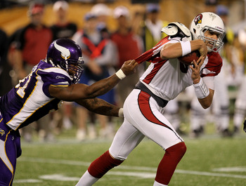 MINNEAPOLIS - NOVEMBER 7: Defensive end Ray Edwards #91 of the Minnesota Vikings grabs the jersey of quarterback Derek Anderson #3 of the Arizona Cardinals at Hubert H. Humphrey Metrodome on November 7, 2010 in Minneapolis, Minnesota.  The Vikings won 27-