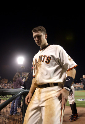 SAN FRANCISCO - OCTOBER 07:  Buster Posey #28 of the San Francisco Giants walks of the field after they beat the Atlanta Braves in game 1 of the NLDS at AT&T Park on October 7, 2010 in San Francisco, California.  (Photo by Ezra Shaw/Getty Images)