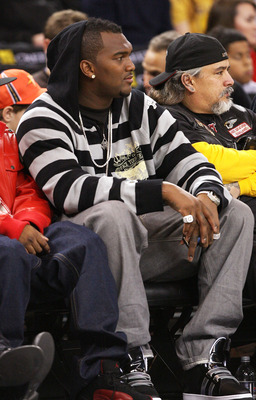 OAKLAND, CA - DECEMBER 28:  Quarterback of the Oakland Raider JaMarcus Russell looks on during the Boston Celtics and the Golden State Warriors NBA game at Oracle Arena on December 28, 2009 in Oakland, California. NOTE TO USER: User expressly acknowledges
