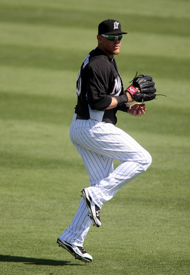 JUPITER, FL - MARCH 04:  Logan Morrison #20 of the Florida Marlins throws against the New York Mets at Roger Dean Stadium on March 4, 2011 in Jupiter, Florida.  (Photo by Marc Serota/Getty Images)