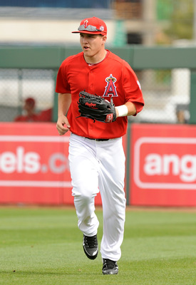 TEMPE, AZ - FEBRUARY 26:  Mike Trout #90 of the Los Angeles Angels of Anaheim runs in from right field between innings against the Los Angeles Dodgers at Tempe Diablo Stadium on February 26, 2011 in Tempe, Arizona.  (Photo by Norm Hall/Getty Images)