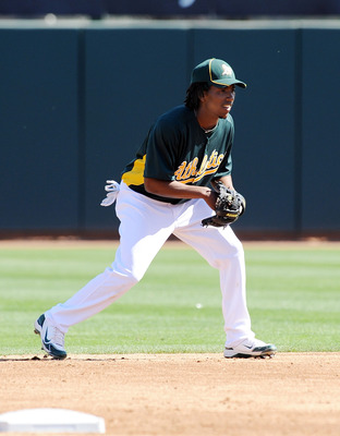 PHOENIX, AZ - MARCH 04:  Jemile Weeks #59 of the Oakland Athletics gets ready at second base against the Texas Rangers at Phoenix Municipal Stadium on March 4, 2011 in Phoenix, Arizona.  (Photo by Norm Hall/Getty Images)