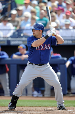 PEORIA, AZ - MARCH 01:  Mitch Moreland #18 of the Texas Rangers at bat against the Seattle Mariners during spring training at Peoria Stadium on March 1, 2011 in Peoria, Arizona.  (Photo by Harry How/Getty Images)