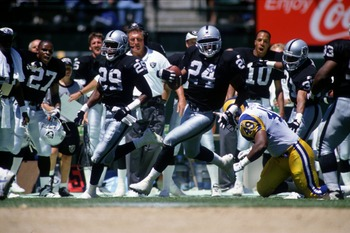 8 Nov 1995:  Defensive back Patrick Bates #24 of the Los Angeles Raiders carries the ball after intercepting a pass during the Raiders 27-22 win over the Los Angeles Rams at Memorial Coliseum in Los Angeles, California. Mandatory Credit: Otto Greule/ALLSP