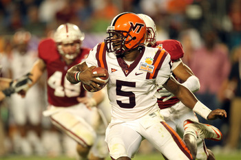 MIAMI, FL - JANUARY 03:  Quarterback Tyrod Taylor #5 of the Virginia Tech Hokies runs with the ball against the Stanford Cardinal during the 2011 Discover Orange Bowl at Sun Life Stadium on January 3, 2011 in Miami, Florida. Stanford won 40-12. (Photo by