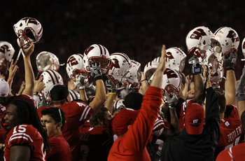 MADISON, WI - OCTOBER 16: Wisconsin Badger players and fans celebrate a win over the Ohio State Buckeyes at Camp Randall Stadium on October 16, 2010 in Madison, Wisconsin. Wisconsin defeated Ohio State 31-18. (Photo by Jonathan Daniel/Getty Images)