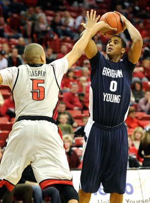 LAS VEGAS, NV - JANUARY 05:  Brandon Davies #0 of the Brigham Young University Cougars shoots against Derrick Jasper #5 of the UNLV Rebels during their game at the Thomas & Mack Center January 5, 2011 in Las Vegas, Nevada. BYU won 89-77.  (Photo by Ethan