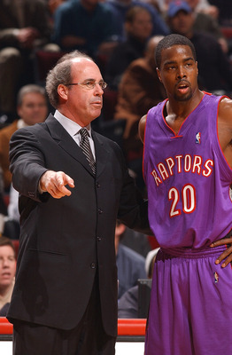 CHICAGO - FEBRUARY 17:  Head coach Kevin O'Neill of the Toronto Raptors gives instructions to guard Alvin Williams #20 during a game against the Chicago Bulls on February 17, 2004 at the United Center in Chicago, Illinois. The Bulls defeated the Raptors 7