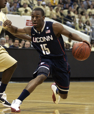 PITTSBURGH, PA - DECEMBER 27:  Kemba Walker #15 of the Connecticut Huskies drives to the basket against Ashton Gibbs #12 of the Pittsburgh Panthers at Petersen Events Center on December 27, 2010 in Pittsburgh, Pennsylvania.  (Photo by Justin K. Aller/Gett