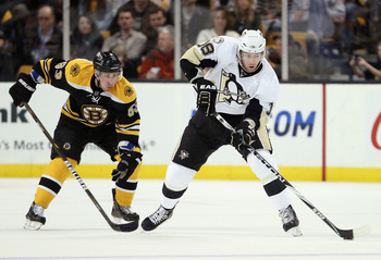 BOSTON, MA - MARCH 05: James Neal #18 of the Pittsburgh Penguins takes the puck as Brad Marchand #63 of the Boston Bruins defends on March 5, 2011 at the TD Garden in Boston, Massachusetts.  (Photo by Elsa/Getty Images)
