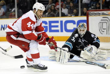 SAN JOSE, CA - MARCH 3: Todd Bertuzzi #44 of the Detroit Red Wings has the puck knocked away by goalie Antti Niemi #31 of the San Jose Sharks in the third period of an NHL hockey game at the HP Pavilion on March 3, 2011 in San Jose, California. The Sharks