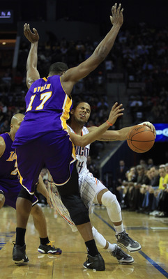 CHARLOTTE, NC - FEBRUARY 14:  Andrew Bynum #17 of the Los Angeles Lakers fouls D.J. Augustin #14 of the Charlotte Bobcats during their game at Time Warner Cable Arena on February 14, 2011 in Charlotte, North Carolina. NOTE TO USER: User expressly acknowle