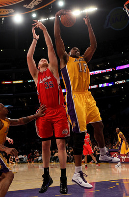 LOS ANGELES, CA - FEBRUARY 25:  Andrew Bynum #17 of the Los Angeles Lakers grabs a rebound from Chris Kaman #35 of the Los Angeles Clippers at Staples Center on February 25, 2011 in Los Angeles, California. The Lakers won 108-95.  NOTE TO USER: User expre