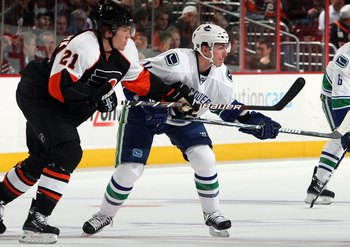 PHILADELPHIA - DECEMBER 03:  Alexandre Burrows #14 of the Vancouver Canucks skates against James van Riemsdyk #21 of the Philadelphia Flyers on December 3, 2009 at Wachovia Center in Philadelphia, Pennsylvania. The Canucks defeated the Flyers 3-0.  (Photo