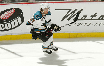 DETROIT - FEBRUARY 29:  Brian Campbell #51 of the San Jose Sharks skates against the Detroit Red Wings during their NHL game at Joe Louis Arena February 29, 2008 in Detroit, Michigan.(Photo By Dave Sandford/Getty Images)