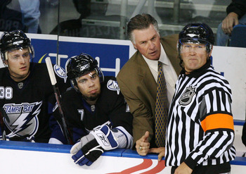 TAMPA, FL - SEPTEMBER 22:  Head coach Barry Melrose of the Tampa Bay Lightning discusses a call with referee Don Koharski #12 during action against the Pittsburgh Penguins in a preseason game at the St. Pete Times Forum on September 22, 2008 in Tampa, Flo