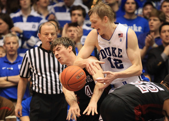 DURHAM, NC - FEBRUARY 23:  Juan Fernandez #4 of the Temple Owls runs into Kyle Singler #12 of the Duke Blue Devils during their game at Cameron Indoor Stadium on February 23, 2011 in Durham, North Carolina.  (Photo by Streeter Lecka/Getty Images)