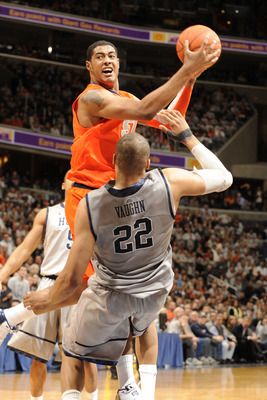 WASHINGTON, DC - FEBRUARY 26:  Fab Melo #51 of the Syracuse Orange takes a shot over Julian Vaughn #22 of the Georgetown Hoyas during a college basketball game on February 26, 2011 at the Verizon Center in Washington, DC  The Orange 58-51.  (Photo by Mitc