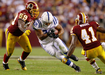 LANDOVER, MD - OCTOBER 17:  Running back Mike Hart #32 of the Indianapolis Colts is tackled by London Fletcher #59 and Kareem Moore #41 of the Washington Redskin at FedExField on October 17, 2010 in Landover, Maryland. The Colts won the game 27-24.  (Phot