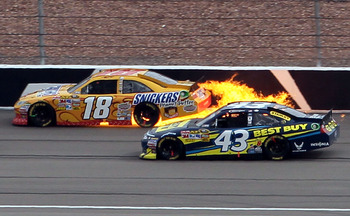 LAS VEGAS, NV - MARCH 06:  Kyle Busch's #18 Snickers Toyota catches fire after his engine blew up during the NASCAR Sprint Cup Series Kobalt Tools 400 at Las Vegas Motor Speedway on March 6, 2011 in Las Vegas, Nevada.  (Photo by Jeff Gross/Getty Images)