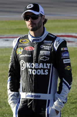 LAS VEGAS, NV - MARCH 04:  Jimmie Johnson, driver of the #48 Lowe's Chevrolet, stands on the grid during qualifying for the NASCAR Sprint Cup Series Kobalt Tools 400 at Las Vegas Motor Speedway on March 4, 2011 in Las Vegas, Nevada.  (Photo by John Harrel