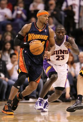 PHOENIX - JANUARY 23:  Corey Maggette #50 of the Golden State Warriors hanldes the ball during the NBA game against the Phoenix Suns at US Airways Center on January 23, 2010 in Phoenix, Arizona. The Suns defeated the Warriors 112-103.  NOTE TO USER: User