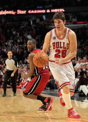 CHICAGO, IL - JANUARY 15:  Kyle Korver #26 of the Chicago Bulls collects a rebound and sets up for the game winning three point field goal with 25 seconds remaining in the game against Mario Chamlers #15 of the Miami Heat at the United Center on January 1