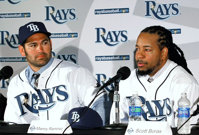ST PETERSBURG, FL - FEBRUARY 01:  Johnny Damon #22 and Manny Ramirez #24 of the Tampa Bay Rays talk with reporters at a press conference at Tropicana Field on February 1, 2011 in St Petersburg, Florida.  (Photo by J. Meric/Getty Images)