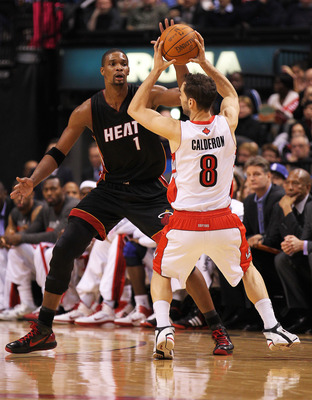 TORONTO, CAN - FEBRUARY 16:  Chris Bosh #1 of the Miami Heat defends against Jose Calderon #8 of the Toronto Raptors in a game on February 16, 2011 at the Air Canada Centre in Toronto, Canada. The Heat defeated the Raptors 103-95. (Photo by Claus Andersen