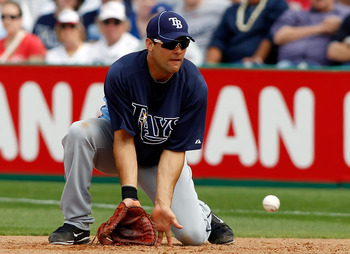 CLEARWATER, FL - MARCH 06:  First baseman Casey Kotchman #23 of the Tampa Bay Rays fields this ground ball against the Philadelphia Phillies during a Grapefruit League Spring Training Game at Bright House Field on March 6, 2011 in Sarasota, Florida.  (Pho