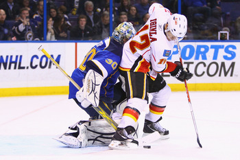 ST. LOUIS, MO - MARCH 1: Jarome Iginla #12 of the Calgary Flames backs into Ben Bishop #30 of the St. Louis Blues at the Scottrade Center on March 1, 2011 in St. Louis, Missouri.  (Photo by Dilip Vishwanat/Getty Images)
