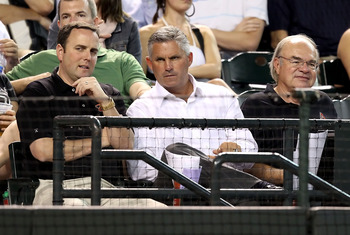 PHOENIX - SEPTEMBER 22:  (L-R) President & Chief Executive Officer Derrick Hall, Executive Vice President & General Manager Kevin Towers and Managing General Partner Ken Kendrick of the Arizona Diamondbacks attend the Major League Baseball game against th