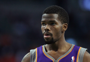 BOSTON, MA - MARCH 02:  Aaron Brooks #0 of the Phoenix Suns looks on before a free throw against the Boston Celtics on March 2, 2011 at the TD Garden in Boston, Massachusetts.  The Celtics defeated the Suns 115-103. NOTE TO USER: User expressly acknowledg