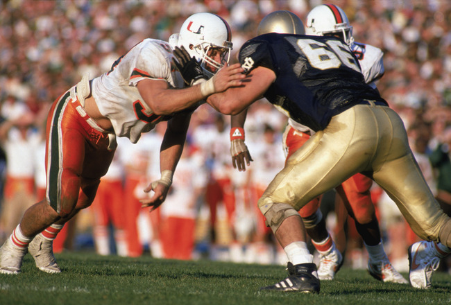 MIAMI - OCTOBER 15:  Bill Hawkins #54 of the University of Miami Hurricanes moves on the field during a game against Notre Dame Fighting Irish on October 15, 1988 in Miami, Florida. Notre Dames won 31-30. (Photo by: Jonathan Daniel/Getty Images)