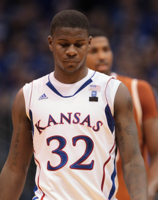 LAWRENCE, KS - JANUARY 22:  Josh Selby #32 of the Kansas Jayhawks walks off the court during a timeout during the game against the Texas Longhorns on January 22, 2011 at Allen Fieldhouse in Lawrence, Kansas.  (Photo by Jamie Squire/Getty Images)