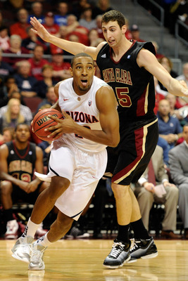 LAS VEGAS - NOVEMBER 26:  Derrick Williams #23 of the Arizona Wildcats drives in front of Marc Trasolini #15 of the Santa Clara Broncos during the third round of the Las Vegas Invitational at The Orleans Arena November 26, 2010 in Las Vegas, Nevada.  (Pho