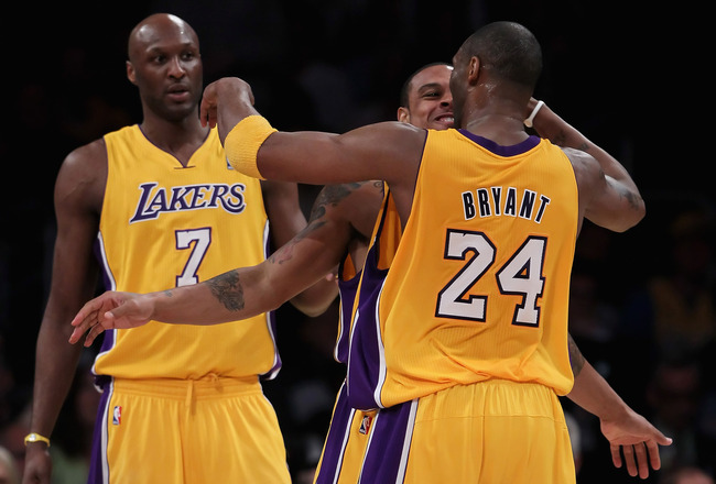 LOS ANGELES, CA - FEBRUARY 22:  (L-R) Lamar Odom #7, Shannon Brown #12 and Kobe Bryant #24 of the Los Angeles Lakers celebrate after Brown made a basket while being fouled against the Atlanta Hawks in the second half at Staples Center on February 22, 2011