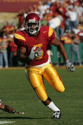 LOS ANGELES, CA - DECEMBER 03: (FILE PHOTO) Reggie Bush #5 of the USC Trojans rushes the ball against the UCLA Bruins December 3, 2005 at the Los Angeles Memorial Coliseum in Los Angeles, California. Bush was picked second overall by the New Orleans Saint
