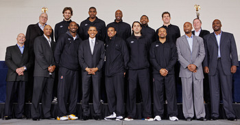 WASHINGTON, DC - DECEMBER 13:  (AFP OUT) U.S. President Barack Obama (Bottom row 4L)) poses for photographs with members of the 2010 NBA Championship Los Angeles Lakers during an event at the Boys and Girls Club at THEARC   December 13, 2010 in Washington