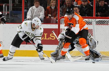 PHILADELPHIA, PA - FEBRUARY 05:  Scott Hartnell #19 of the Philadelphia Flyers skates against Karlis Skrastins #37 of the Dallas Stars on February 5, 2011 at Wells Fargo Center in Philadelphia, Pennsylvania. The Flyers defeated the Stars 3-1.  (Photo by J