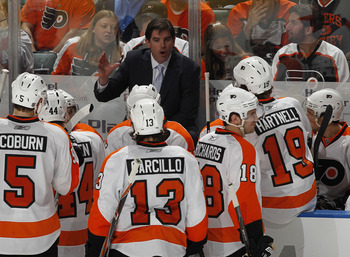 SUNRISE, FL - FEBRUARY 16: Head coach Peter Laviolette of the Philadelphia Flyers talks to the team during a time out against the Florida Panthers on February 16, 2011 at the BankAtlantic Center in Sunrise, Florida. The Flyers defeated the Panthers 4-2. (