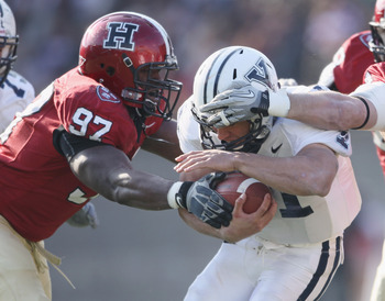 CAMBRIDGE, MA - NOVEMBER 20:  Chuks Obi #97 of the Harvard Crimson tackles Alex Thomas #41 of the Yale Bulldogs on November 20, 2010 at Harvard Stadium in Cambridge, Massachusetts.  Harvard defeated Yale 28-21.  (Photo by Elsa/Getty Images)