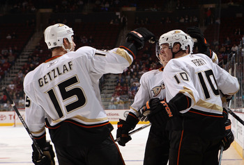 GLENDALE, AZ - NOVEMBER 27:  Corey Perry #10 of the Anaheim Ducks celebrates with Ryan Getzlaf #15 after Perry scored a third period goal against the Phoenix Coyotes during the NHL game at Jobing.com Arena on November 27, 2010 in Glendale, Arizona. The Du